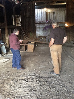 men,barn,junk,dirt floor