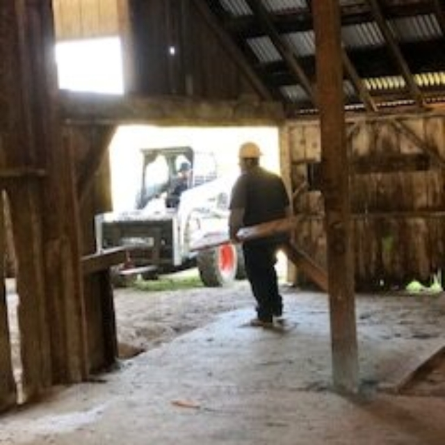 tractor,worker,barn,wood