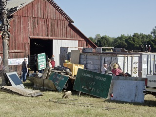 barn,roof,metal,junk,signs,people