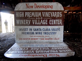 sign,big,wine,barn,person