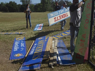 sign,pile,blue,tickets,event,festival,people