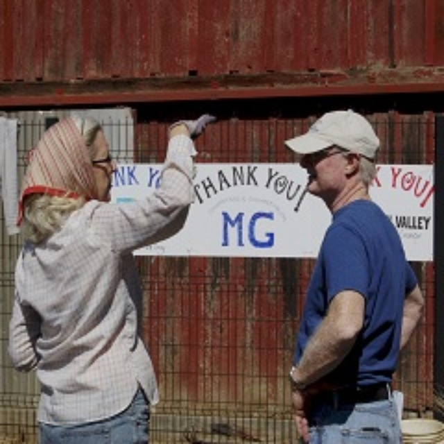 man,woman,talking,hat,scarf,sign,barn