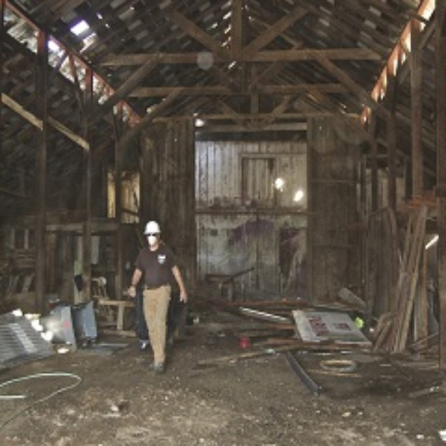 man,junk,barn,helmet,mask