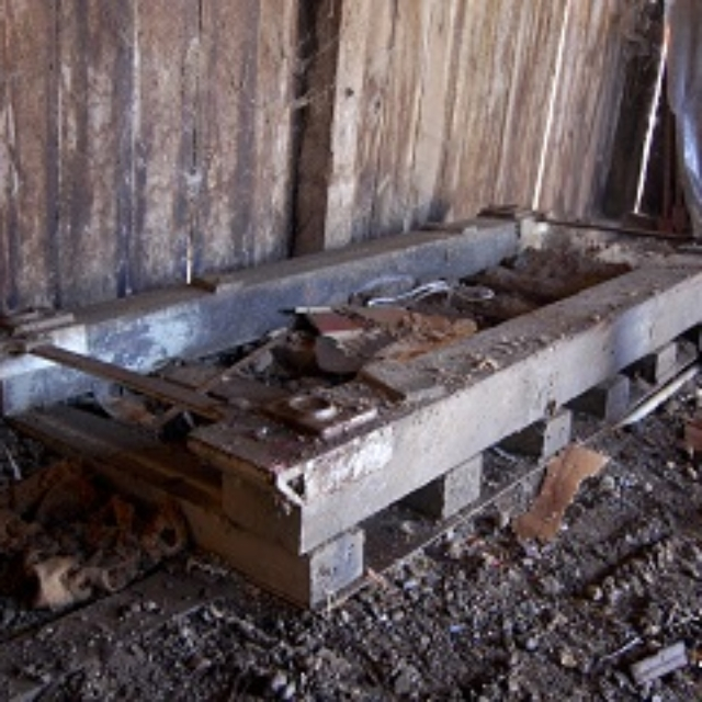 barn,wood,cinder block,metal,dirt